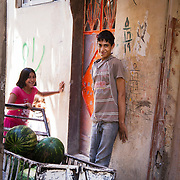 In Ein El-Hilweh refugee camp, home to 75.000 Palestinians. Mohammed and his siblings outside their front door. Mohammed is 15 and has only just regained his ability to walk after years of psychological treatment by Naba'a psychologist Rouda Ismael.  Developmental Action Without Borders(Naba'a) work in Palestinian refugee camps across Lebanon to help children in the camps.  The camps are densely over-crowded and many of the children are 4th generation refugees living in Lebanon with no citizenship or rights and under immense pressure. Naba'a is a mix of Palestinians and Lebanese and aim to give children a sense of security and freedom to express their needs and rights.Naba'a operates in communities governed by a multitude of political parties and religious groups and Naba'a keeps a strict independed line from any affiliation with any groups.