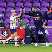 ORLANDO, FL - JANUARY 22:  Megan Rapinoe #15 of United States high fives head coach Vlatko Andonovski of United States after being replaced against Colombia at Exploria Stadium on January 22, 2021 in Orlando, Florida. (Photo by Alex Menendez/Getty Images) *** Local Caption *** Megan Rapinoe; Vlatko Andonovski
