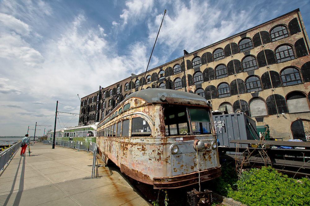 A pre-Civil War cotton and coffee warehouse with its antique trolley cars out front, Red Hook, Brooklyn