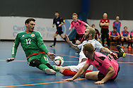 Scotland goalkeeper Ben Tough saves from Jonathan Adams of England. England v Scotland match, Home nations Futsal tournament at the Cardiff city House of Sport in Cardiff, South Wales on Friday 2nd December 2016. This inaugural tournament played over 3 days brings together teams from Wales, England, Scotland and Northern Ireland. <br /> pic by Andrew Orchard, Andrew Orchard sports photography.