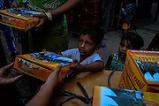 BAYEUN, ACEH, INDONESIA - JULY 11 : <br /> Child of Rohingya migrant received food from volunteer to break fasting at temporary shelter camp in Bayeun, East Aceh, Indonesia on July 11. 2015. The boatpeople in Aceh are among thousands of Rohingya and Bangladeshi migrants who arrived in countries across Southeast Asia in May after a Thai crackdown threw the people-smuggling trade into chaos.<br /> ©Nira Cahaya/Exclusivepix Media