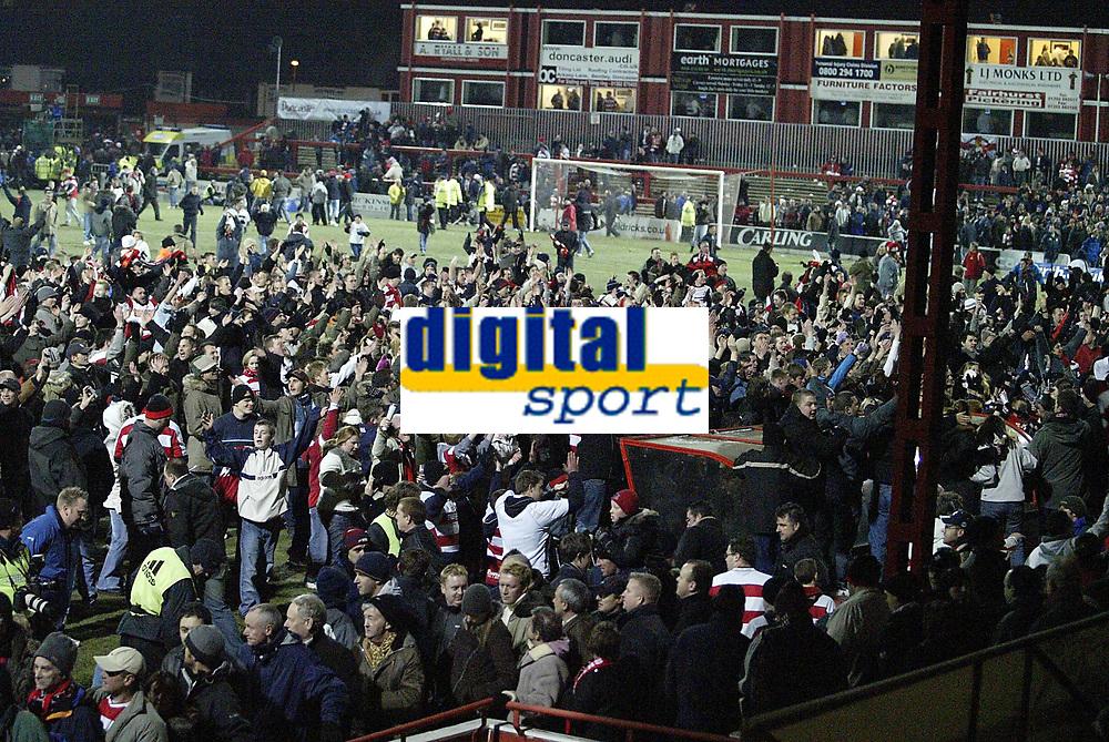 Photo: Aidan Ellis.<br /> Doncaster Rovers v Aston Villa. Carling Cup. 29/11/2005.<br /> Doncaster fans celebrte winning 3-0 on the pitch