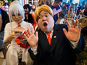 "05 NOVEMBER 2017 - BANGKOK, THAILAND: A ""Donald Trump"" cosplayer pretends to react to Robert Mueller coming into the hall during a cosplay event at Paragon, an upscale shopping mall in the center of Bangkok.     PHOTO BY JACK KURTZ"