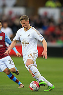 Stephen Kingsley of Swansea city in action.Barclays Premier league match, Swansea city v Aston Villa at the Liberty Stadium in Swansea, South Wales on Saturday 19th March 2016.<br /> pic by  Andrew Orchard, Andrew Orchard sports photography.