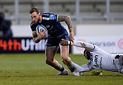 Sale Sharks wing Byron McGuigan breaks a tackle by Bath Rugby's wing Semesa Rokoduguni during a Gallagher Premiership Round 9 Rugby Union match, Friday, Feb 12, 2021, in Leicester, United Kingdom. (Steve Flynn/Image of Sport)
