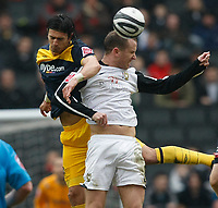 Photo: Steve Bond/Richard Lane Photography. MK Dons v Southampton. Coca-Cola Football League One. 20/03/2010. Jose Fonte (L) is booked for use of the elbow during this challange with Aaron Wilbraham