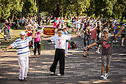 Chinese people take part in dance exercise early morning at the Temple of Heaven Park during summer in Beijing, China