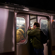 A man tries to board an uptown 4 train at the 14th Street Union Square Station in Manhattan, New York on Tuesday, January 22, 2019. John Taggart for The New York Times