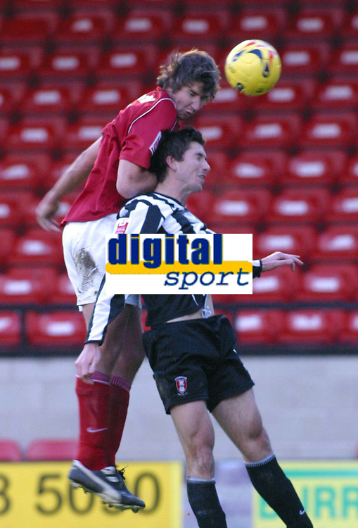 Photo: Dave Linney.<br />Walsall v Rotherham United. Coca Cola League 1.<br />26/11/2005.Ian Roper(Walsall) rises above Shaun Baker(Rotherham) to win the header.