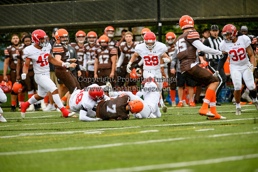 CHILLIWACK, BC - SEPTEMBER 11:  Isaac Wegner #7 of Okanagan Sun is tackled by the Westshore Rebels at Exhibition Stadium in Chilliwack, BC, Canada. (Photo by Marissa Baecker/Shoot the Breeze)