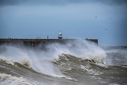 @Licensed to London News Pictures 27/01/2016. Folkestone, Kent, Large waves swamping the Harbour Arm today (27 01 2016) at Folkestone on the south coast of Kent. High winds and torrential rains are forecast for the most of the UK. Photo credit: Manu Palomeque/LNP