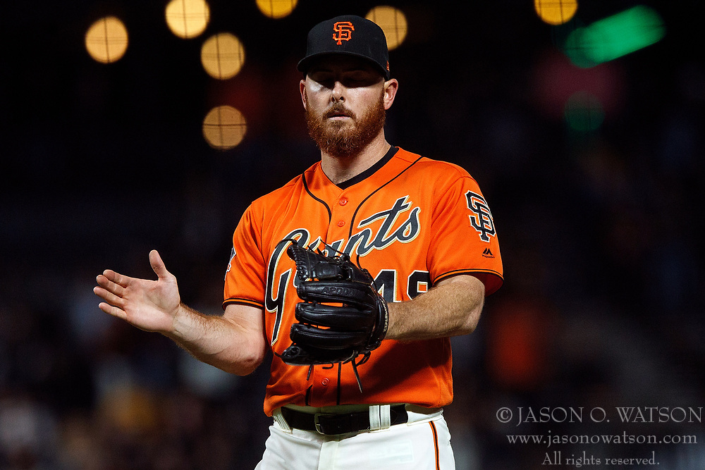 SAN FRANCISCO, CA - JULY 13: Sam Dyson #49 of the San Francisco Giants celebrates after the game against the Oakland Athletics at AT&T Park on July 13, 2018 in San Francisco, California. The San Francisco Giants defeated the Oakland Athletics 7-1. (Photo by Jason O. Watson/Getty Images) *** Local Caption *** Sam Dyson