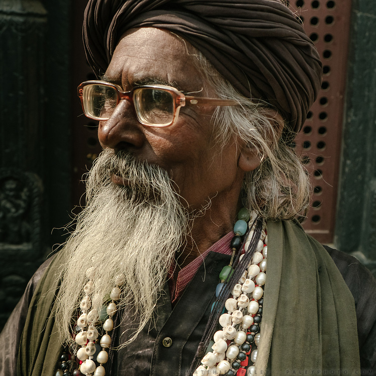 A Sadhu wearing skull bead necklace in Pashupatinath, a famous Shiva temple complex that wedded couple come to visit.