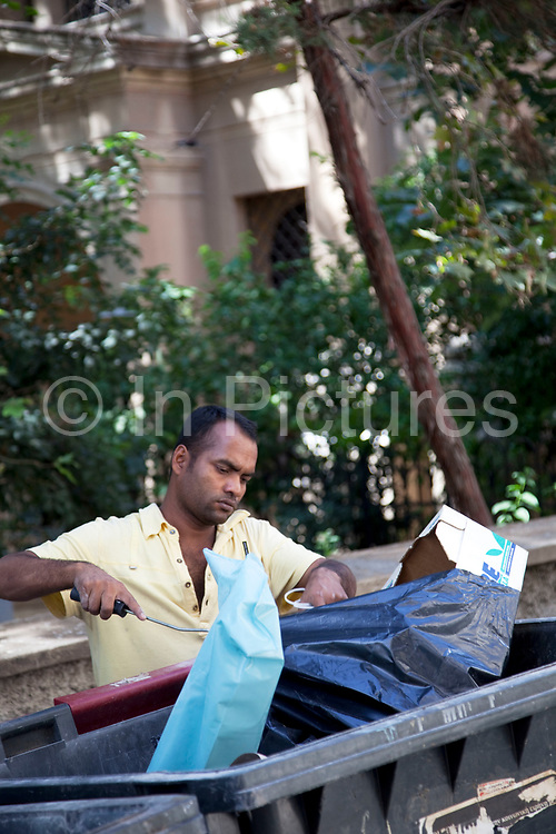 Immigrants recycling waste to make a little money in the area of Kolonaki, a chic and fashionable area. This is a common site in every corner of the capital as austerity measures make every cent count. The people clearing bins of recyclable waste are often Pakistani, Afghani or Somali. Athens is the capital and largest city of Greece. It dominates the Attica periphery and is one of the world's oldest cities, as its recorded history spans around 3,400 years. Classical Athens was a powerful city-state. A centre for the arts, learning and philosophy.