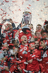 December 9, 2017 - Toronto, Ontario, Canada - Toronto FC midfielder MICHAEL BRADLEY (4) lifts the MLS CUP with his team.  Toronto wins the MLS Cup championship match at BMO Field in Toronto, Canada.  Toronto FC defeats Seattle Sounders 2 to 0. (Credit Image: © Mark Smith via ZUMA Wire)