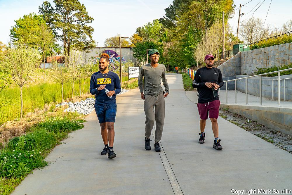 Atlanta Beltline access at Cascade Road. Westside Atlanta, near Gordon White Park. Lone walkers, bikers and groups of people enjoying time on the Beltline