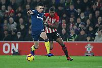 Football - 2018 / 2019 Premier League - Southampton vs. West Ham United<br /> <br /> Declan Rice of West Ham United stops Southampton's Mario Lemina at St Mary's Stadium Southampton<br /> <br /> COLORSPORT/SHAUN BOGGUST