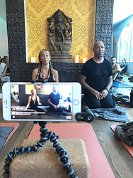 """Russell Simmons releases a photo on Twitter with the following caption: """"""""Watch #SoulSunday lecture live on my Facebook page right now @TantrisYoga"""""""". Photo Credit: Twitter *** No USA Distribution *** For Editorial Use Only *** Not to be Published in Books or Photo Books ***  Please note: Fees charged by the agency are for the agency's services only, and do not, nor are they intended to, convey to the user any ownership of Copyright or License in the material. The agency does not claim any ownership including but not limited to Copyright or License in the attached material. By publishing this material you expressly agree to indemnify and to hold the agency and its directors, shareholders and employees harmless from any loss, claims, damages, demands, expenses (including legal fees), or any causes of action or allegation against the agency arising out of or connected in any way with publication of the material."""