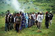 Without looking back, Xhosa initiates leave the initiation camp, where they have spent about a month in seclusion. December 2006 in Ciskei, Eastern Cape Province, South Africa. The camp is set on fire after their departure as a symbolic farewell to childhood. The traditional Xhosa male initiation rite, which transforms the teenager into an adult man, starts with circumcision. The initiates then spend about a month in a special initiation camp, away from settled areas.