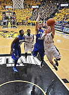 WICHITA, KS - JANUARY 18:  Guard Ron Baker #31 of the Wichita State Shockers drives in for a score past guard Jake Odum #13 of the Indiana State Sycamores during the second half on January 18, 2014 at Charles Koch Arena in Wichita, Kansas.  Wichita State defeated Indiana State 68-48. (Photo by Peter Aiken/Getty Images) *** Local Caption *** Ron Baker;Jake Odum