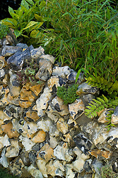 Flint wall. Over the Hills and Far Away Garden. Design: Kevin Cooper and Linda Fairman - Chelsea 2005