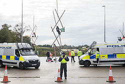 West Hyde, UK. 9th September, 2020. Hertfordshire Police officers proceed to remove anti-HS2 activists from tripods used to block entrances to the Chiltern Tunnel South Portal site for the HS2 high-speed rail link for the entire day. The protest action by anti-HS2 activists, at the site from which HS2 Ltd intends to drill a 10-mile tunnel through the Chilterns, was intended to remind Prime Minister Boris Johnson that he committed to remove deforestation from supply chains and to provide legal protection for 30% of UK land for biodiversity by 2030 at the first UN Summit on Biodiversity on 30th September.