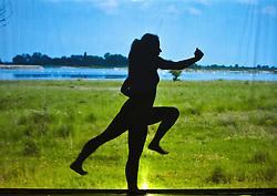 05.05.2011, Ferry Porsche CONGRESS CENTER, Zell am See, AUT, IRONMAN 70.3 Salzburg, im Bild eine weibliche Silhouette beim laufen Schattenspiele während der Präsentations- Pressekonferenz des Ironman 70.3 Zell am See Kaprun, der am 26. August 2012 erstmals über die Bühne geht // a feminine silhouette in the shadow run, EXPA Pictures © 2011, PhotoCredit: EXPA/ J. Feichter