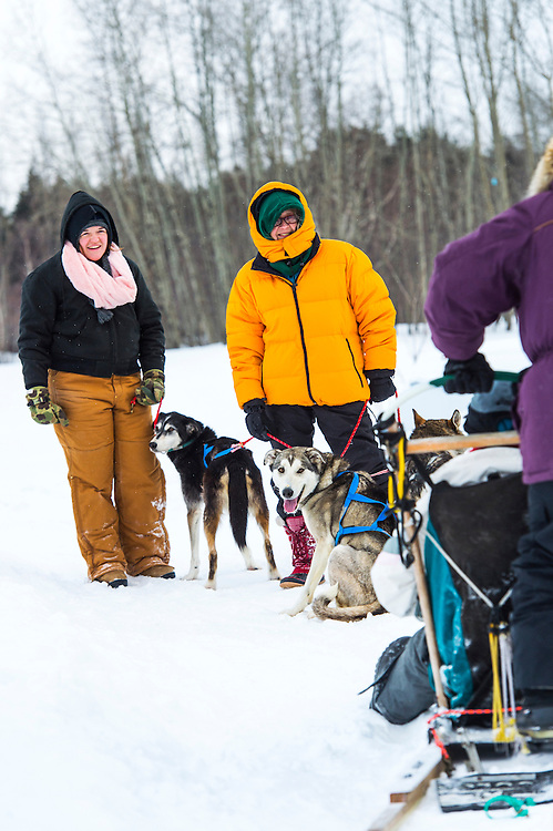Participants in the Michigan DNR Becoming an Outdoors Woman program learn mushing at Bay Cliff Health Camp in Big Bay, Michigan.