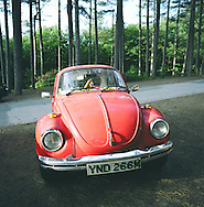 A Volkswagen Beetle car parked at Ainsdale nature reserve at Formby in Liverpool Bay at the mouth of the river Mersey. The Mersey is a river in north west England which stretches for 70 miles (112 km) from Stockport, Greater Manchester, ending at Liverpool Bay, Merseyside. For centuries, it formed part of the ancient county divide between Lancashire and Cheshire.