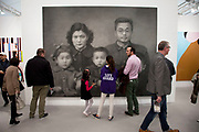 Our Parents by Zhang Huan. Visitors and exhibitors at the many galleries exhibiting at the Frieze Art Fair 2012. This art fair is for work at the high end of international contemporary art with many well known artists on show from many of the world's most reknowned dealers.