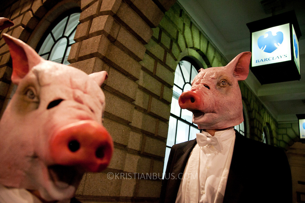 """8 men dressed in tuxedos and wearing pigs heads tried to join the Lord Mayor's Banquet in London, pointing out that the banquet is for the 1 % of society and not the 99%. """"The 8 distinguished members of the Willindon club were then forced to seek sustenance at Occupy LSX."""