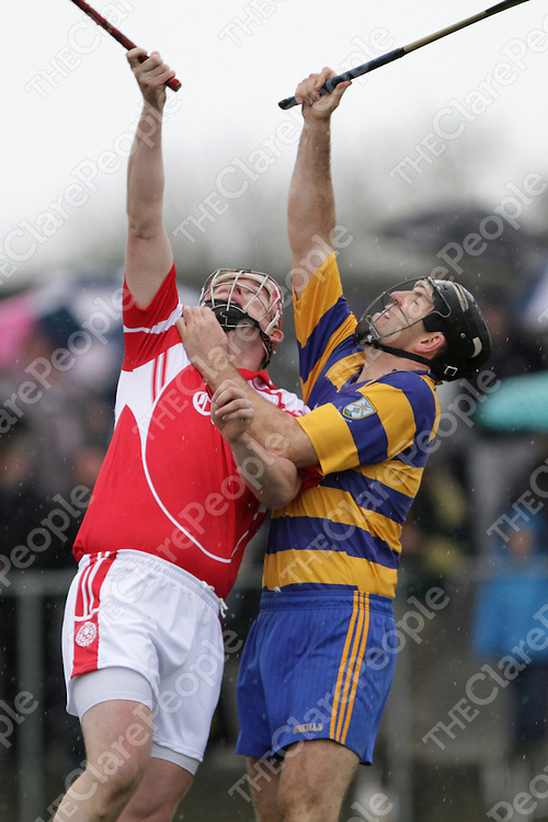 Eire Óg's Barry Nugent about to direct the ball to the net against Ruan's Niall O'Connor for the games only goal.<br /> Photograph by Flann Howard
