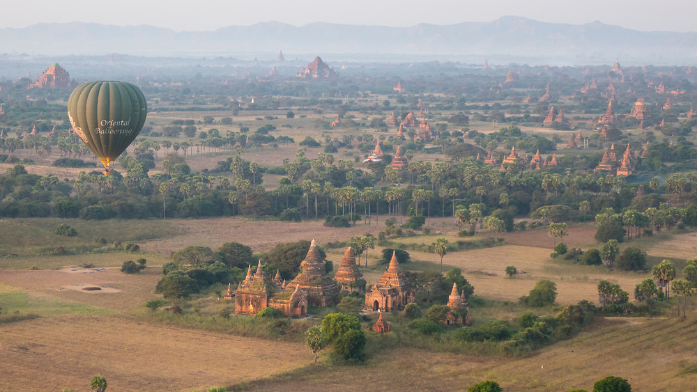 View of Bagan from a hot air balloon. It is an ancient city and a UNESCO World Heritage Site in the Mandalay Region of Myanmar. In the Bagan plains alone the remains of over 2200 temples and pagodas survive.