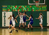 Newfound's Ashlee Dukette and Somersworth's Alysha Fauci go after a rebound on senior night basketball Thursday evening.  (Karen Bobotas/for the Laconia Daily Sun)