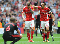 Football - 2018 / 2019 EFL Sky Bet League One Play-Off Final - Sunderland vs. Charlton<br /> <br /> Jason Pearce (6) puts his arm round , a stunned winning goalscorer, Patrick Bauer at the final whistle, at Wembley Stadium.<br /> <br /> COLORSPORT/ANDREW COWIE