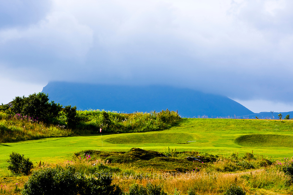 Norway, golf course under cloudy sky, elevated view