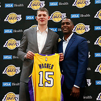EL SEGUNDO, CA - JUN 26: NBA 2018 draft pick Moritz Wagner #15 of the Los Angeles Lakers pose with his agent Joe Branch during an introductory press conference at the UCLA Health Training Center on June 26, 2018 in El Segundo, California.
