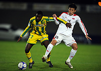 La Roche sur Yon FC Nantes v Korea  DPR (0-0) 09/10/2009<br /> Kim Yong Yun (DPR Korea) Ismail Koita (FC Nantes)<br /> North Korea make a rare appearance in the West having already qualified for World Cup 2010. Their last appearance in a major competiition was World Cup 1966 when they famously knocked Italy out of the tournament.<br /> Photo Roger Parker Fotosports International