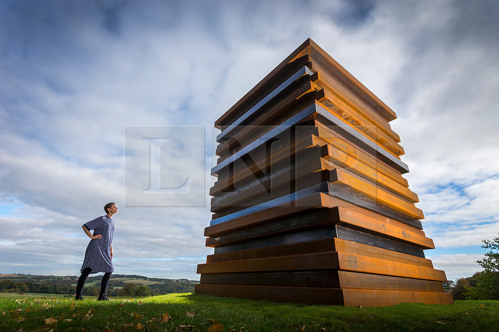 © Licensed to London News Pictures. 27/09/2018. Wakefield UK. Kerry Chase looks at a Sean Scully sculpture called Moor Shadow Stack. Yorkshire Sculpture Park has unveiled a major new exhibition called Inside Outside & is the work of Sean Scully. The exhibition is the first by the Irish-born artist in the UK & is made up of Sculptures & paintings by Scully. The exhibition runs from the 29th of September until the 6th January. Photo credit: Andrew McCaren/LNP