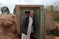 © under license to London News Pictures. 24/02/2011. Two men exit an underground prison at the Army Compound in the Libyan city of Benghazi. Photo credit should read Michael Graae/London News Pictures