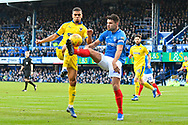 Tennai Watson (2) of AFC Wimbledon battles for possession with Gareth Evans (26) of Portsmouth during the EFL Sky Bet League 1 match between Portsmouth and AFC Wimbledon at Fratton Park, Portsmouth, England on 1 January 2019.