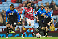 Joleon Lescott of Aston Villa (C) in action with Joshua King (L) and Matt Ritchie of Bournemouth.<br /> Barclays Premier League match, Aston Villa v AFC Bournemouth at Villa Park in Birmingham, The Midlands on Saturday 09th April 2016.<br /> Pic by Ian Smith, Andrew Orchard Sports Photography.