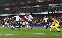 18 November 2017 London : Premier League Football : Arsenal v Tottenham Hotspur - Alexandre Lacazette of Arsenal is beaten to the ball by Eric Dier of Tottenham, as Davinson Sanchez and goalkeeper Hugo Lloris cover.<br /> (photo by Mark Leech)