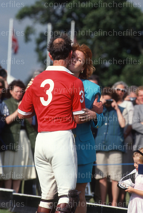 Sarah, Duchess of York seen kissing Prince Charles,The Prince of Wales as she greets him at the Royal Berkshire Polo Club in 1991. Photograph by Jayne Fincher