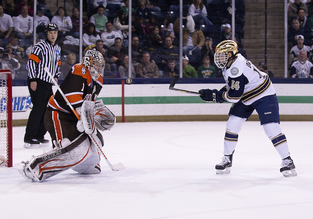 March 15, 2013:  Bowling Green goaltender Andrew Hammond (1) makes the save on shot by Notre Dame center Thomas DiPauli (14) during NCAA Hockey game action between the Notre Dame Fighting Irish and the Bowling Green Falcons at Compton Family Ice Arena in South Bend, Indiana.  Notre Dame defeated Bowling Green 1-0 in overtime.