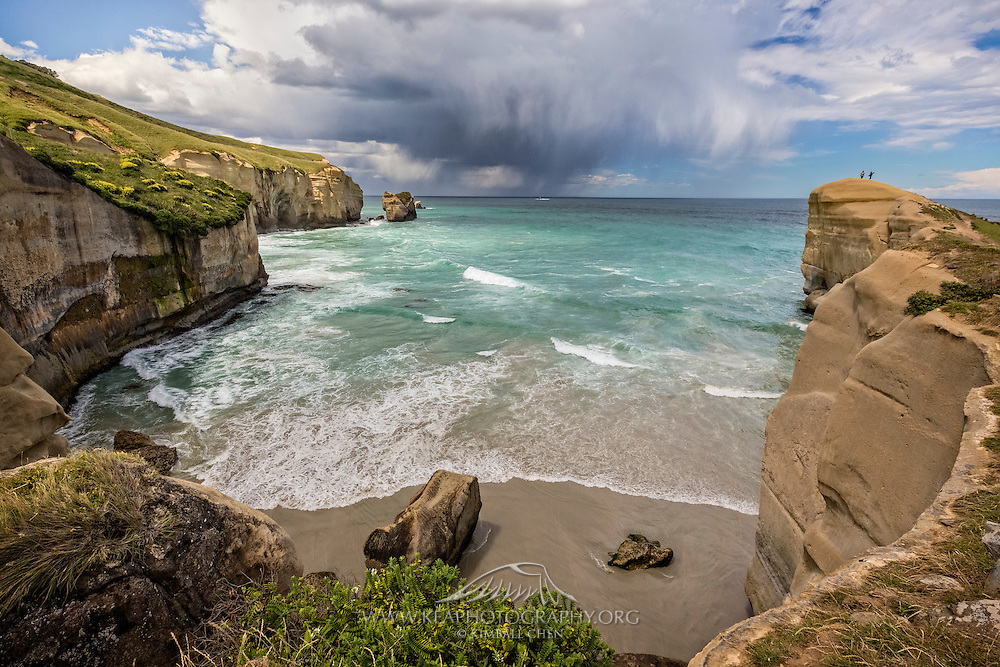 An intense storm moves towards the horizon, at Tunnel Beach, New Zealand.  As quickly as the storm clouds had formed overhead, it then sped off towards the distant horizon.
