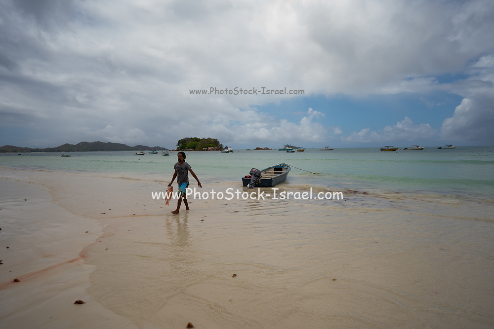 Fishing on tropical island beach. Photographed in Seychelles