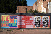 Local response to Coronavirus is felt on a street by street level as posters are pasted up on a hoarding promoting community love and belief, reading: Love each other, We can do this  and Please believe these days will pass on 13th April 2020 in Birmingham, England, United Kingdom. Coronavirus or Covid-19 is a new respiratory illness that has not previously been seen in humans. While much or Europe has been placed into lockdown, the UK government has announced more stringent rules as part of their long term strategy, and in particular social distancing.