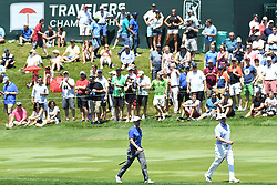 June 25, 2017 - Cromwell, Connecticut, U.S - Rory McIlroy and Rod Sampling approach the 17th green during the final round of the Travelers Championship at TPC River Highlands in Cromwell, Connecticut. (Credit Image: © Brian Ciancio via ZUMA Wire)