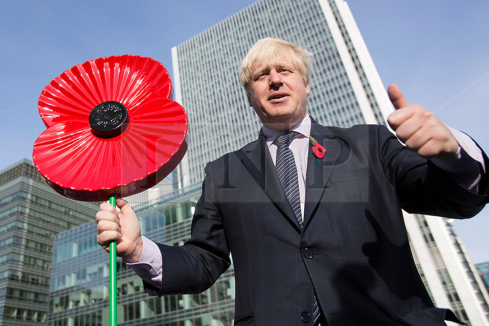 © licensed to London News Pictures. London, UK 30/10/2012. Boris Johnson posing with a poppy on HMS Severn as he launched London Poppy Day with the captain and crew of HMS Severn in Canary Wharf. Photo credit: Tolga Akmen/LNP